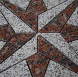 Granieten tegels in windroos